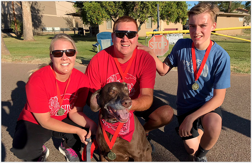 Laura, Darin, and Andrew Arnott after the Race Against the Rolls 5k.