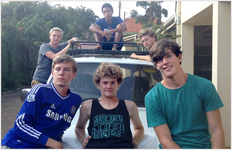 Austin with friends on the hood of a car