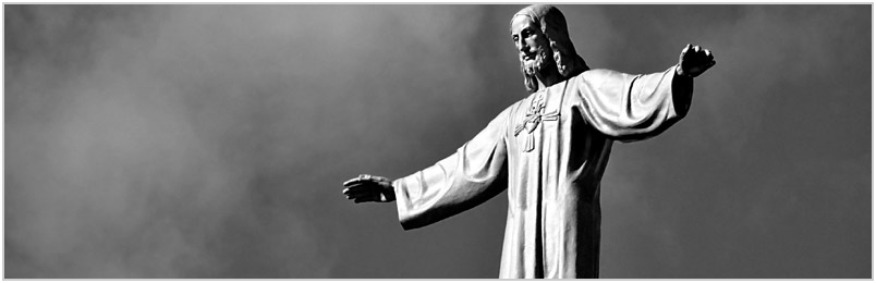 A statue of Jesus with arms outstretched