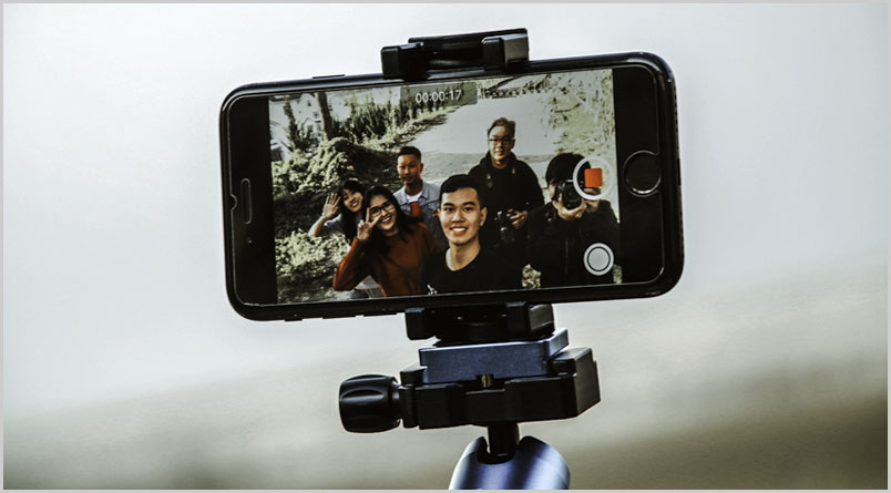 Photo of a video greeting being recorded on a cell phone