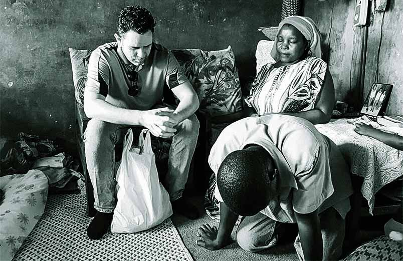 Photo of two men and a woman praying