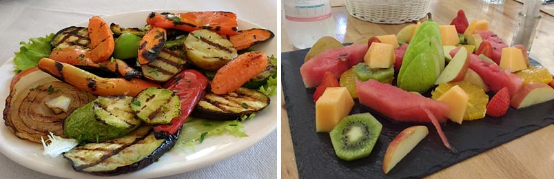 photo of a plate of grilled vegetables and a plate of fresh fruit