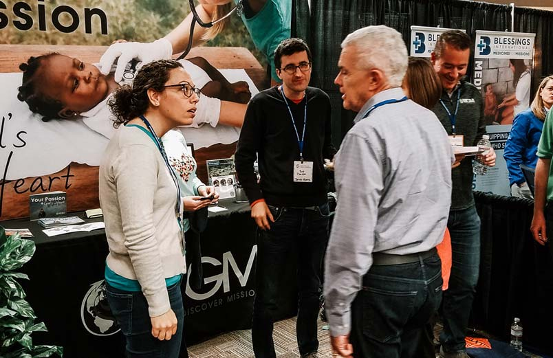 Andrea and Bob Parker talk with a visitor at the WGM booth at the conference.