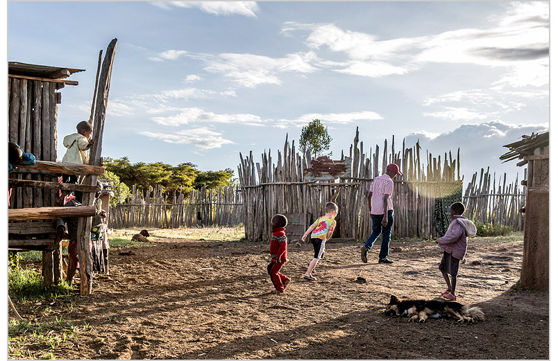 Caleb playing with Kenyan kids.