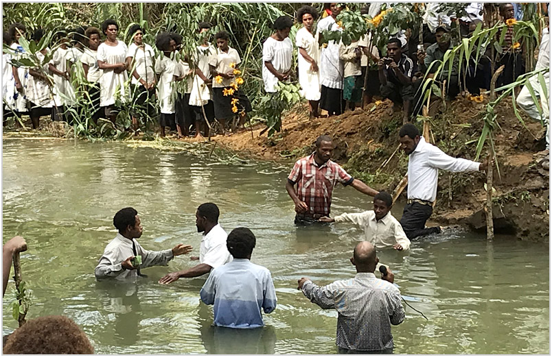 51 people being baptized in a creek