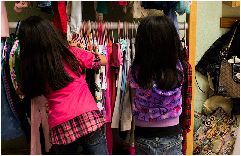 Two girls looking at clothing in the Sparrow's Nest.