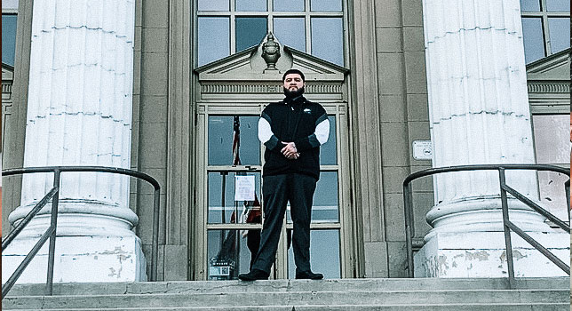 Napoleon standing in front of a courthouse